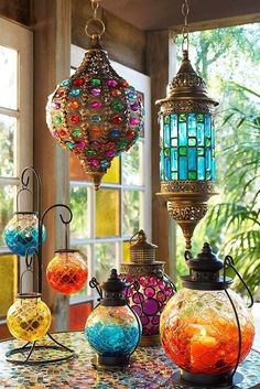With hand-stained glass panels and jewel-encrusted everything, Pier 1's exclusive Medallion and Caravan Gem Lanterns give you a very colorful reason to stay out after dark. Come explore all of our lanterns and find your favorites. Moroccan Lanterns, Moroccan Decor, Moroccan Style, Moroccan Bedroom, Moroccan Interiors, Moroccan Lighting, Moroccan Garden, Deco Cool, String Lights Outdoor