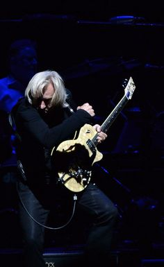 Joe Walsh Photos - Joe Walsh of the Eagles performs during 'History of the Eagles Live in Concert' at the Bridgestone Arena on October 2013 in Nashville, Tennessee. - History of the Eagles Live in Concert