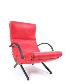 Osvaldo Borsani beautiful P40 relaxing chair by Tecno/Italy in thick red leather with brass details and original rubber armrests. The condition is very good.