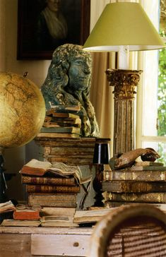 """A wonderful old world charm vignette with a charming """"collected feel"""" inspired by gorgeous antique books."""