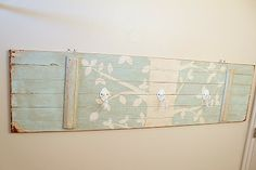 towel rack made from old door at http://garagesalesrus.blogspot.com/2012/04/i-saw-this-on-pinterest-which-inspired.html