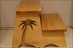 Wooden Step Stool with Palm Tree - This handmade wooden step stool has so much to offer:  It's sturdy It's beautiful It's a great height And it's a handy bench.   The palm tree design adds a nice touch of decor making it a fun step stool to fit anywhere in your home. It would look great in your kitchen, bathroom, bedroom, porch... anywhere.  I like this step stool because it is very sturdy and looks great.  The stool can be custom ordered in maple, oak, or poplar wood.