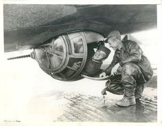 1943- U.S. 8th Air Force gunner climbs into the Sperry ball turret of a B-17 for a demonstration of the bomber's fire power at an RAF station in England.