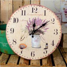 Zegar prowansalski, z motywem lawendy, posiadający tarczę o średnicy 34 cm, która jest specjalnie lekko postarzana co dodaje niesamowitego klimatu całej dekoracji.