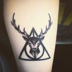 Nice Black Deer Head With Hallows Tattoo