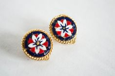 Check out this item in my Etsy shop https://www.etsy.com/listing/251759208/vintage-white-flower-enamel-earrings