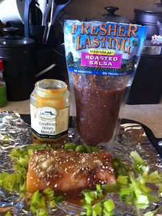 Roasted salsa and Raspberry honey mustard salmon.  1/2 fillet wild caught salmon, 1/3 cup roasted salsa, 2 tbs honey mustard, green onions, onion, parsley, and ginger. Season the bottom if the foil with ging  er, salsa, onion ANC parsley, prick salmon with fork and place directly ontop of the seasonings. Season the top of the salmon with the remaining ingredients. Fold foil into a pocket and allow to marinate for a couple hours. Bake at 375 degrees for 25-30 minutes.