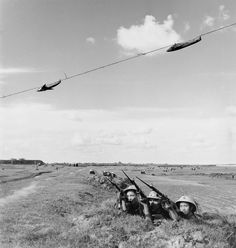 September 1965 Using overhead targets, a militia company practices firing ahead of speeding aircraft in Thanh Tri. Even using antiquated WWII rifles such as these, the Vietnamese were able to crippleaircraft.