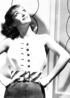 Everything I've read about Joan Crawford (Lucille LeSueur) reveals a disadvantaged child with a dream and gumption. Finding what opportunities there were, she fought through trials and elbowed her way to be noticed. Initially showgirl in a chorus line, then small parts in silents, she transitioned well to talkies. Seen here with pencil-thin brows and no shoulder pads, she radiates a lovely femininity in the early 1930s.