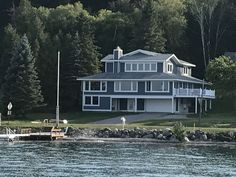 Beautiful Lake Charlevoix Close To Downtown Boyne City And Boyne Mountain. Enjoy this beautiful newly remodeled 5200 sq. foot 7 bedroom 5 bathroom home equip. Boyne City, Michigan, Mountain, Houses, Mansions, Park, Bathroom, House Styles, Beautiful