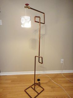this craft would obviously involve my husband. copper lamp.
