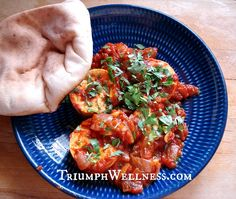 Tofu Shakshuka Recipe Main Dishes with olive oil, onions, garlic, hot pepper, crushed tomatoes, cumin, firm tofu, biscuits, ground black pepper, salt, cilantro, fresh parsley
