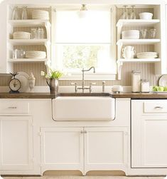 open shelves by the sink? I feel doubtful of the practicality but they look very pretty in this setting.