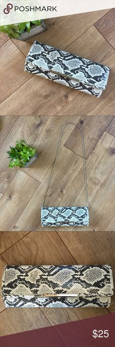 ALDO Snakeskin Clutch Purse ALDO snakeskin clutch or purse. Metal strap to wear over should if desired. No issues. Great condition. Aldo Bags Clutches & Wristlets