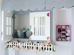 Una+habitación+infantil+decorada+con+un+mueble+casita