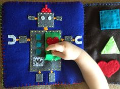 My quiet book, robot with working button.