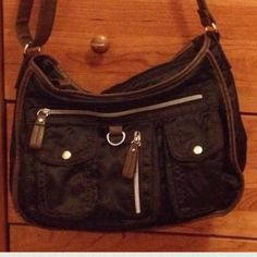 "Nine West Cross Body w/pockets  Nine West Crossbody/messenger•w/pockets on the outside/inside  • silky material black • brown leather trim/bottom • EUC • medium size • (9x4x12"")TRADE Nine West Bags Crossbody Bags"