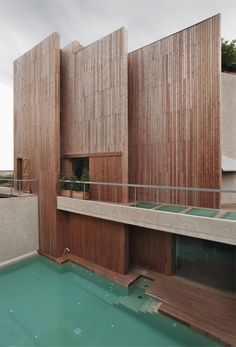 to decrease noise pollution a wooden skin formed by vertical slats covers the back and side fa ade on this home in barcelona designed by BCarquitectos. more architecture on designboom bcarquitectos via designboom- design, exterior, sound, barrier Architecture Résidentielle, Amazing Architecture, Contemporary Architecture, Installation Architecture, Barcelona Architecture, Contemporary Design, Modern Design, Design Exterior, Interior And Exterior