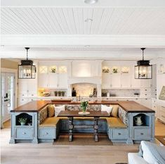 What a lovely gathering area in the kitchen. I'd make the center area (re)moveable.
