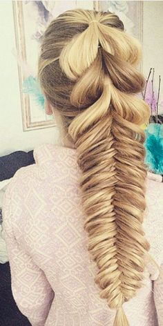 Looks to me like a pull through braid into a fishtail braid...
