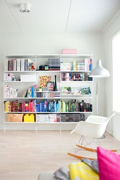 The bookcase adds color and character to such a white space. I likie
