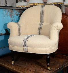 Pair French Napoleon Lumbar Chairs  France  1930's  French Napoleon Chairs upholstered in old French handwoven fabric with blue stripes.  via Liz Sherman