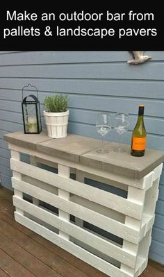 Make a bar out of pallets and landscape pavers