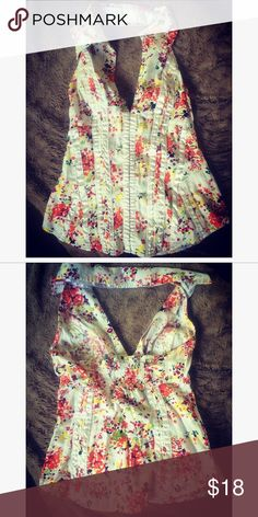 Floral Halter Corset top Excellent condition. Corset clasps in front. Fun for summer nights, looks great with jeans and heels! XOXO Tops Camisoles