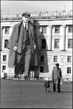 a portrait of LENIN decorates a facade of the winter palace; for may day celebrations and to commemorate the victory over the nazis (9 may), leningrad, soviet union, 1973 photo by henri cartier-bresson/ magnum photos,fromhenri cartier-bresson: europeans