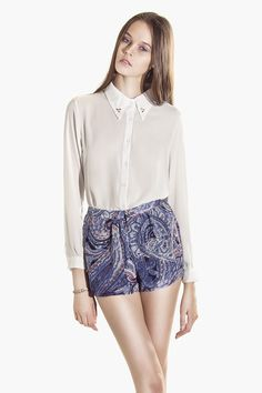 Show off your stems in printed shorts. The Editor's Market Paisley Swirl Shorts will be your best closet friend! We love the awesomely cool swirl prints <3