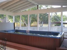 Screened Porch Addition July 2013 After: We installed an Endless Pool that was provided by the client for enjoying the porch even more. Pool Spa, Jacuzzi, Indoor Swimming Pools, Swimming Spa, Lap Pools, Inside Pool, Three Season Room, Hot Tub Garden, Screened In Patio