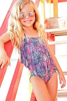 Little Peixoto Magnolia - fringe one piece. The Peixoto Kids Magnolia One Piece features a colorful snake print and designer fringe. The use of this snake print on a fringe top makes it an extra fun one piece for an extra fun girl. Your little girl will want to be rocking this one piece all year long! #kids