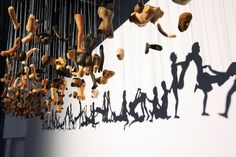 Provocative Shadow Art Created Through Suspended Doll Parts - My Modern Metropolis