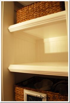 Coat closet turned into built in shelves. She gives a detailed instruction of how she did this. Some good ideas here and how tos. I like the molding she added to the front of each shelf, adds character. She also raised the bottom off the floor.