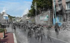 From dark times to blue skies: German prisoners of war are marched through the north-western French city by American soldiers. Historical expert Jo Teeuwisse, from Amsterdam, began the project after finding 300 old negatives at a flea market in her home city depicting familiar places in a very different context.