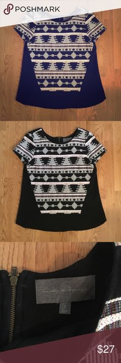 """ANTHROPOLOGIE Tribal Top The coolest ANTHROPOLOGIE Tribal Top by Sunday in Brooklyn. Size Small. High low hem. Black knitted material on sides and back with really cool woven pattern on front. Heavier material makes it perfect for transition to fall. Exposed zipper in back. 100% cotton on front. Rayon, polyester, spandex mix (all black part). Front is approximately 22"""" long and back is approximately 25"""" long. Really cool find!! Anthropologie Tops"""