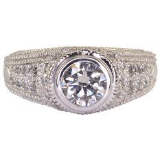 Estate 1.01 carat VVS2 center diamond ring. This 14 karat white gold ring has one 1.01 carat round brilliant diamond at VVS2 clarity K color and accent