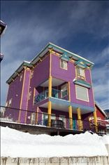 Fun, colorful 4-bedroom home with best ski access on hill in Silver Star, Okanagan. Put on your skis or boards and go. Alpine Meadows lift out the door and ski bridge as well. Large picture windows capitalize on spectacular views of mountain. Other end of house has private deck with beautiful views and BBQ. The rooftop hot tub allows for more amazing views. Summer activities like hiking, biking, paintball. ID#116820 #christmas #holidays #ski #mountain