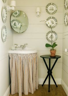 Classic country - a skirted sink and decorative plates on the walls say cozy country in this small bathroom