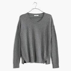 Vented and cropped with a dramatic shirttail hem, this cool textured pullover is one that can span the seasons.