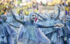 Performers take part in the opening ceremony of the 2014 FIFA World Cup at the Corinthians Arena in Sao Paulo on June 12, 2014. (Dimitar Dil...