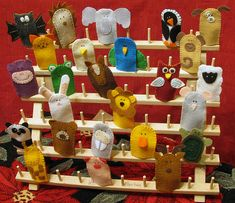 finger puppets stand--spool holder.  GENIUS!!!!!!!!  You could totally paint it a fun color too!