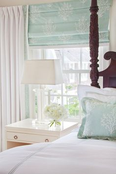 Sea glass colors soothe the heart and mind. I love how the shade and the pillow match, cute guest room?