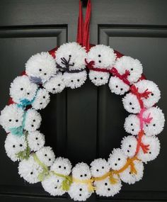Here's a new take on the traditional festive wreath... a pom-pom snowman wreath to welcome family and friends