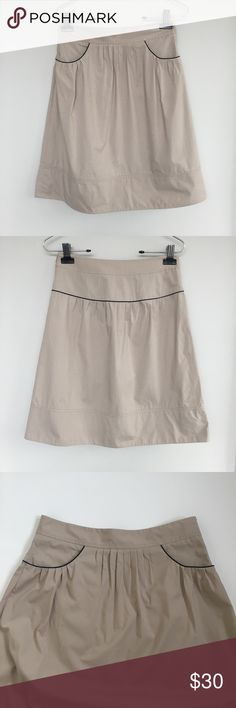 Theory Khaki Beige Pleated Knee Length Skirt Theory Khaki Pleated Skirt w/ Pockets with Black Trim Design - Style: Dania  Size: 2 Material: 96% Cotton 4% Polyeurethane  Condition: Great Condition. Only FLAW is slight marking shown in last photo. Barely visible  Care: Dry Clean only Theory Skirts Midi