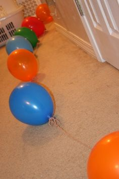 A trail of balloons leading from the bed to the birthday gift when the birthday child wakes up
