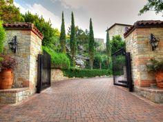 Italian cypress along driveway, stone columns
