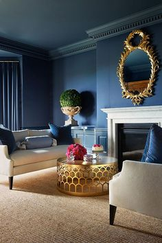 Love the table...perfect Blue walls with cocktail center and home accessories Gold accents.Suggested by BRABBU