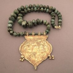 """22ct gold , emeralds, India  Description : A splendid necklace from Radjasthan which combines the emerald beads and  a pendant representing the Tree of Life with its floral and animalist motives… the pendant dates from the 19th century… Weight:89,3gr Lenght:19,68inch Diameter:Pend:2,99 inch x 2,4 www.halter-ethnic.com...see : """"Necklaces and Pendants"""""""