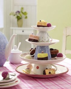 Stacking tea cups and saucers to use as a serving piece...brilliant! --coffee cups and saucers to fit the theme :)